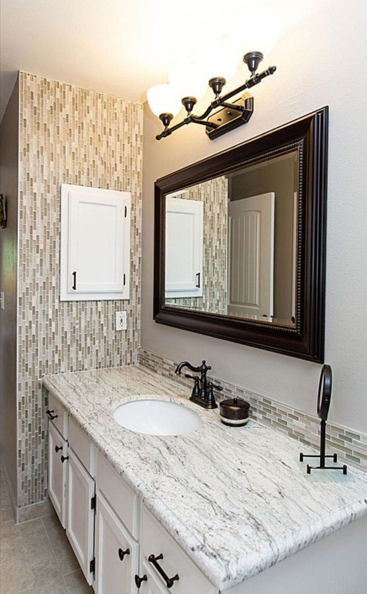 Tiled accent bathroom wall and backsplash. | Home
