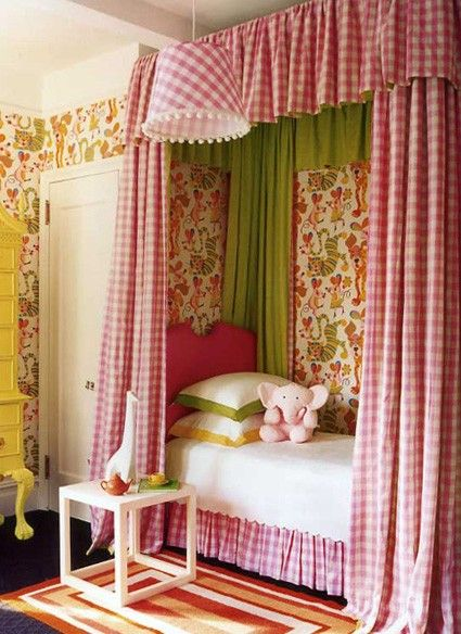 I love how this pink gingham canopy bed and coordinating lamp shade creates a bright and cheery toddler room for a little girl. Discover more kids room decorating and organizing tips and ideas @ http://kidsroomdecorating.net