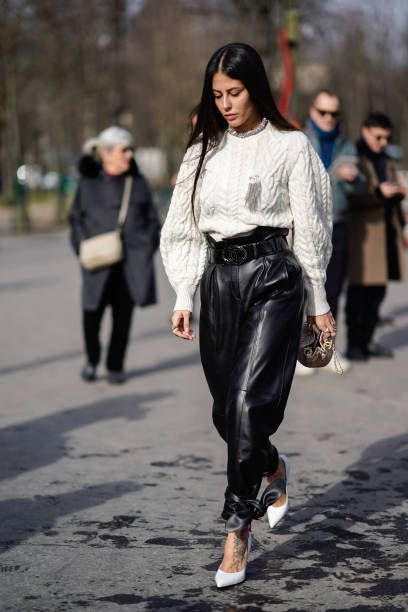 4d4c2a40a049b8 Gilda Ambrosio wears a white top black leather pants white shoes outside  Chanel during Paris Fashion Week Womenswear Fall Winter 2018 2019 on March  6.