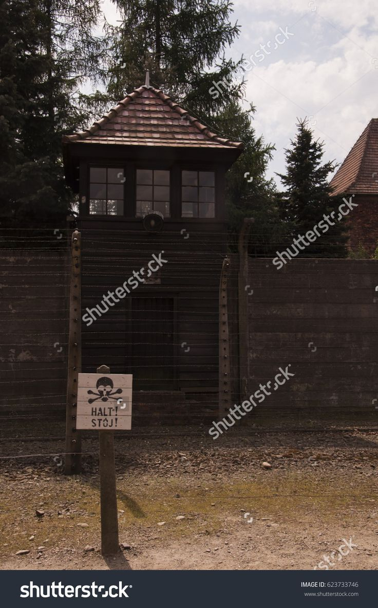 Oswiecim, Poland - May 02, 2012: Watchtower and wire fence in Auschwitz-Birkenau Concentration Camp.
