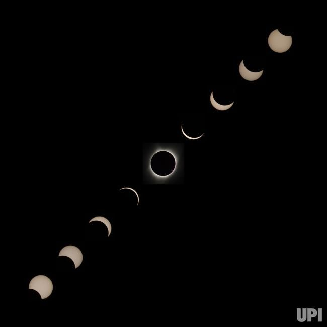 In this composite image from top right to bottom left, the stages of the Moon crossing in front of the Sun are shown for the total solar…