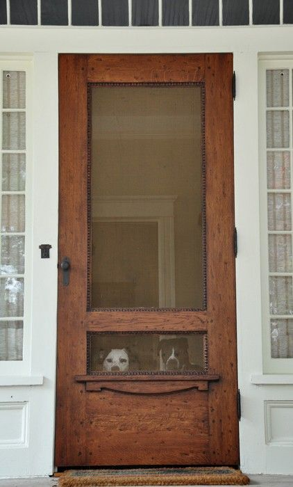 great idea - old wood door into screen door