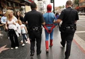 Spider-Man is on the run. Cops in L.A. are hunting the rogue superhero who snatched a cash-packed paper bag Friday from a Starlines Tour Bus Company employee walking down Hollywood Boulevard.