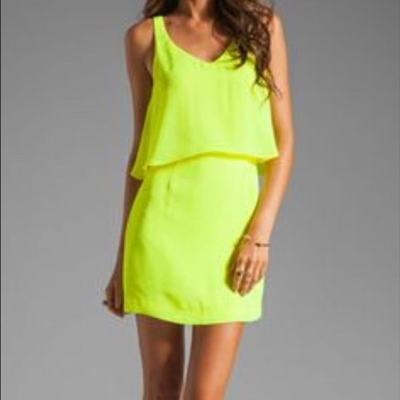 Dolce Vita neon yellow dress Re-posh- not my photos. This dress is super cute and very NEON yellow! such a nice color. It was too small for me. This has no stretch and would best fit a 2 and below. I'm currently a size 4 and it might fit other 4's if you don't have a butt. Slight snag in front. ON SALE PRICE FIRM. Dolce Vita Dresses Mini