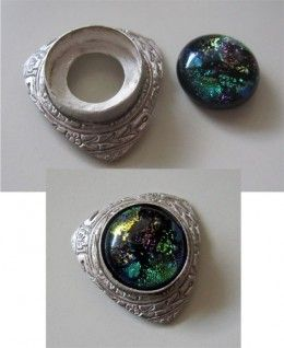 Fine silver bezel wire setting embedded in fine silver metal clay before firing and set with a dichroic glass cabochon after firing.