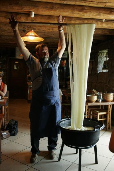 making aligot in central France (cheese & potatoes )