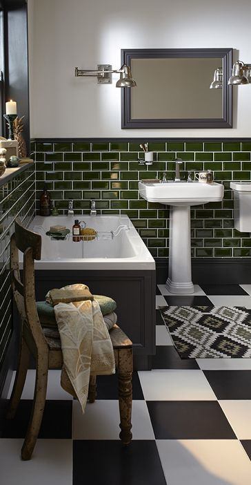 Love the dark green wall tiles with the black and white chequered floor tiles in this art deco style bathroom. Wynwood Bathroom Collection | Heritage®