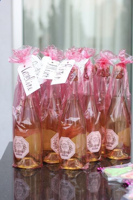 Super cute! Wrap sparkling wine or champagne with a custom label in cellophane that matches your wedding colors! Love this favor idea, although beer might be a better favor from us since we arent big wine drinkers.