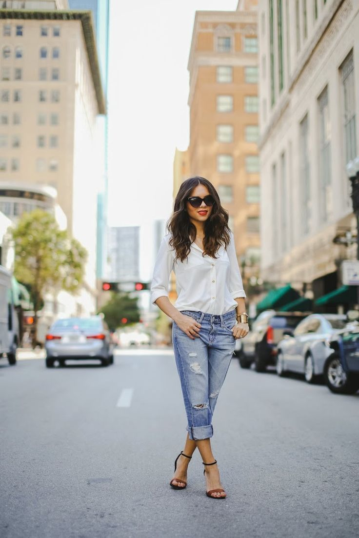 Shop this look for $120:  http://lookastic.com/women/looks/white-button-down-shirt-and-blue-boyfriend-jeans-and-brown-sandals/1503  — White Button Down Shirt  — Blue Boyfriend Jeans  — Brown Sandals