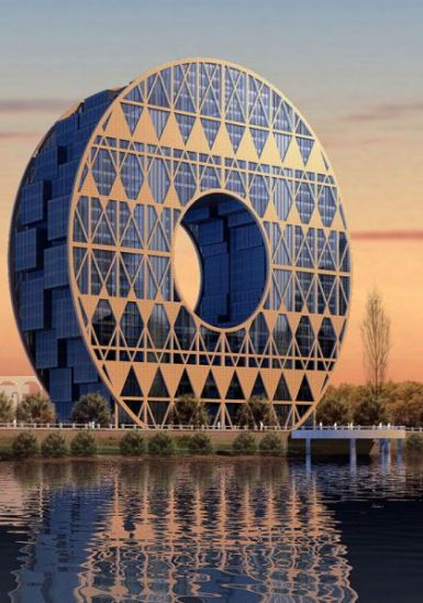 'Lucky' coin-inspired structure on Pearl River, Guangzhou, Architect Joseph di Pasqale.