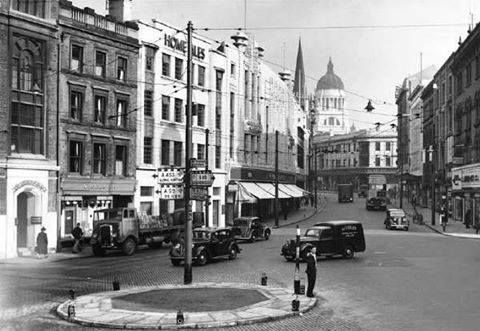 Lister Gate 1950 After the demolition of the Walter Fountain , St Peter's Church spire and Council House dome in the distance. Looking north to the junction of Low Pavement and showing Woolworths and Marks and Spencers stores.