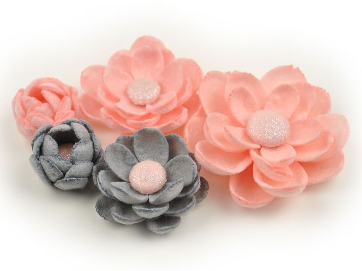 Our burnt felt flowers are cut from our custom flower dies and are individually heat treated on the edges to produce a natural deckle edge and to give the flower it puffed, three-dimensional shape. Flowers feature glittered felt centers and are handmade with great attention to detail and quality. Our flowers are excellent for use as scrapbook embellishments or can be used to make custom brooches, headbands, hair clips, etc. The possibilities are endless!