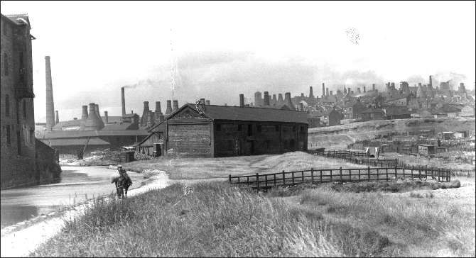 The Mersey Weaver Wharf - Burslem Branch Canal  note the amazing number of bottle ovens on the skyline  The skyline is the district known as Dale Hall - between Burslem and Longport