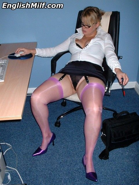 Secretary in purple nylons stockings relaxing at the office flashing her black panties.