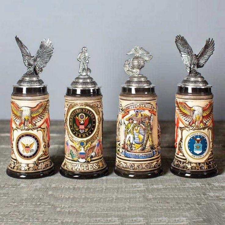 Salute With A Stein  These intricately designed steins honor the U.S. military. The four designs pay homage to the Marine Corps, Air Force, Army and Navy, showcasing a variety of official seals, symbols, flags and banners. A necessity for any military family. Stoneware with pewter lid.  #usmilitary #navy #army #marines #beerstein #militarystein #barware #drinkware #veteran #veterans #airforce