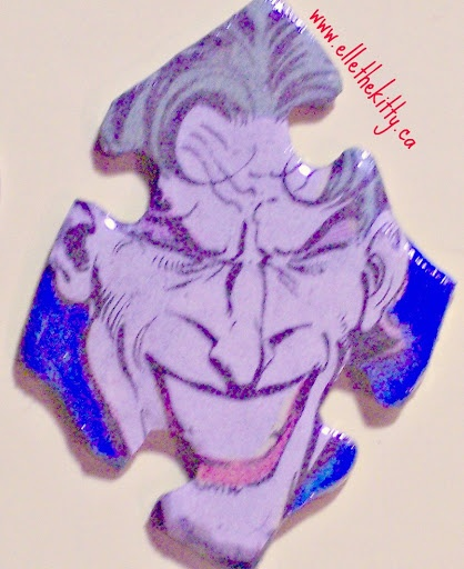 The joker, recycled with hand painted background. Handmade, one of a kind jewelry, recycled comic item. Can be custom ordered as pin, pendant, zipper pull, shoe charm, magnet or other item. All recycled media, no scans or copies.  ONE of a kind art for about $12.  If you like em, please share em.  love, ellethekitty