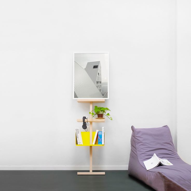 Stilt with a yellow bookshelf and 2 wooden shelves. Holding books, a framed poster, a plant and a pair of headphones. #stilt #easytomove #movable #shelving #ash #wood #mwa #makerswithagendas #mwadesign #agendadrivendesign #mwagram #nomadicliving #multiuse