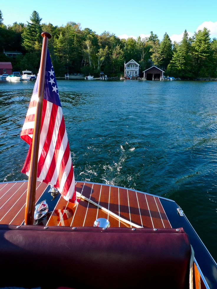 Reminds me of the cabin cruiser our neighbors had in New York. Looks like Cayuga Lake--don't really know where this is, though.