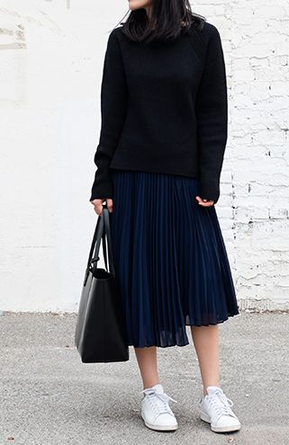 Wear your midi with pride this winter #THEOUTNET pleated midi skirt sneakers minimal outfit