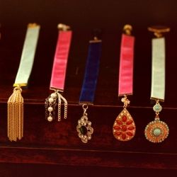 Learn how to make your own ribbon bookmarks with re-purposed jewelry.