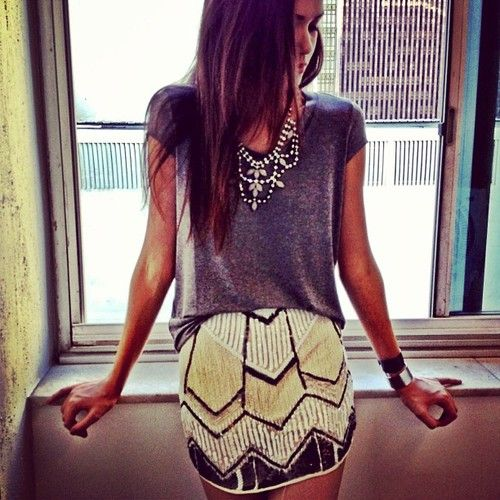 Patterned skirt, basic tee, statement necklace