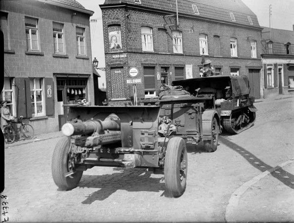A Light Dragon Mk III artillery tractor towing a 25-pdr field gun and limber in Herseaux, as the BEF crosses the border into Belgium, 10 May 1940.