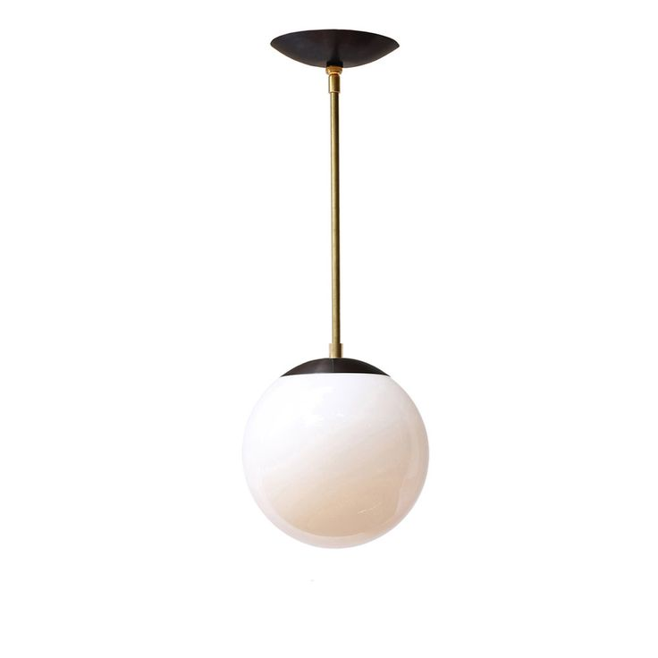 Iconic midcentury reissued.  Other companies sell similar style pendants with generic painted steel parts and thin glass.  Our version of this iconic design features uncompromising quality; solid brass parts with authentic midcentury profiles made exclusively for Cedar & Moss paired with