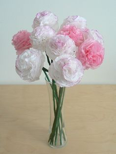 ** tissue paper carnations. I have tons of experience making these!!! I made my wedding bouquets and flowers for the men to wear pinned on their suits too. All done in advance, so nice to not worry about that the day before or day of the wedding! :) AND I got to keeeep them :)