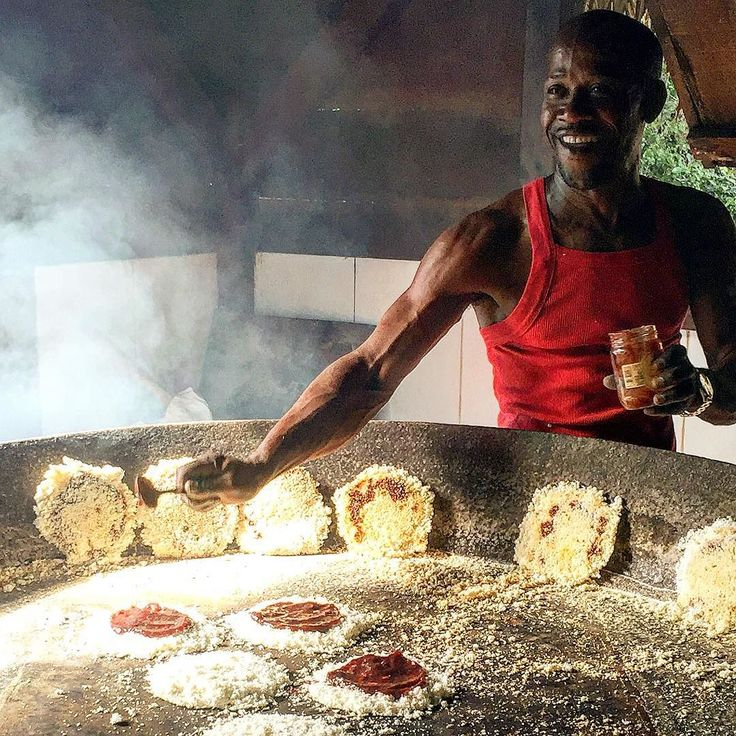 Gilbert LaRose prepares manioc (cassava) cakes for visitors at the Savane des Esclaves in Martinique. He built the working farm to show how escapes and freed slaves might have lived in the 19th century.