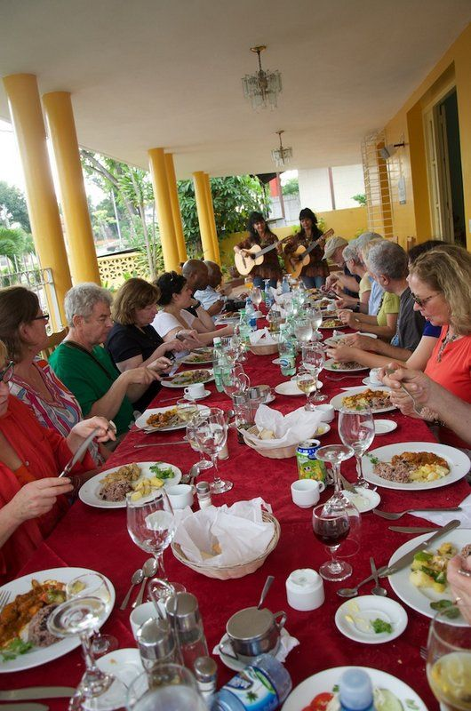 A Chester County Art Association group lunch in Santiago de Cuba, with guitar players playing.  #Cuba #music #paladares
