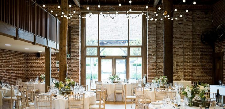 The Mill Barn at Gaynes Park set up for a wedding breakfast