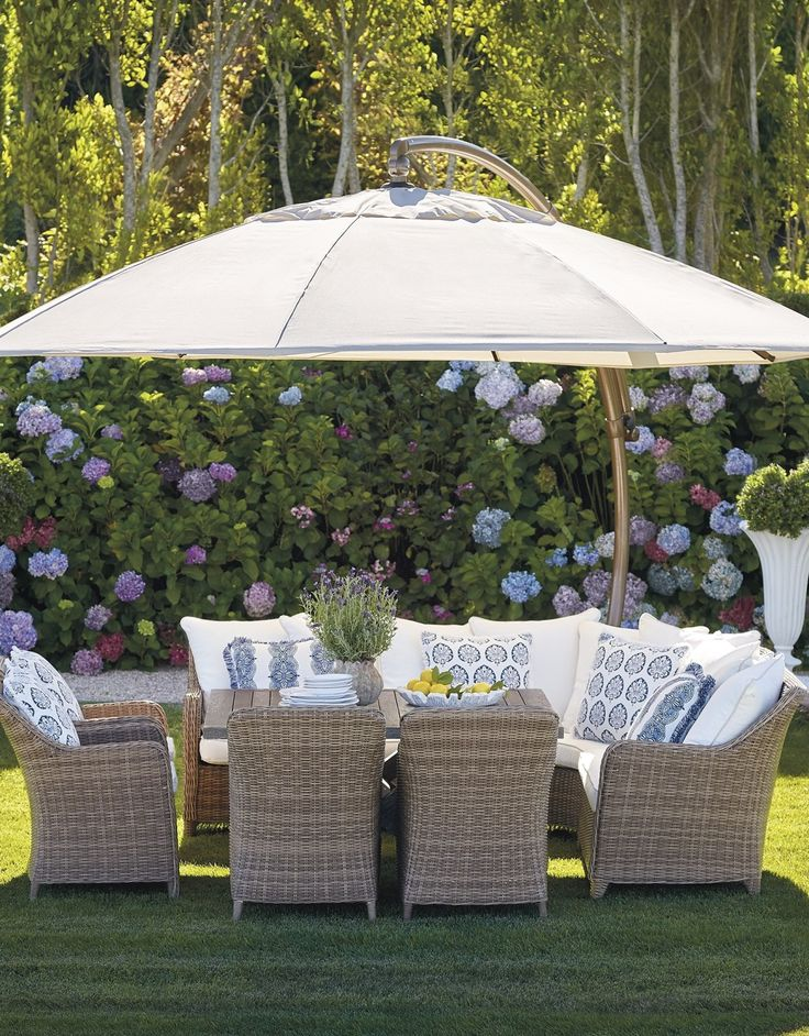 Bowing gently backward like O'Keefe's calla lilies, our handwoven Beaumont Dining Set sighs with the grace of relaxed outdoor dining.