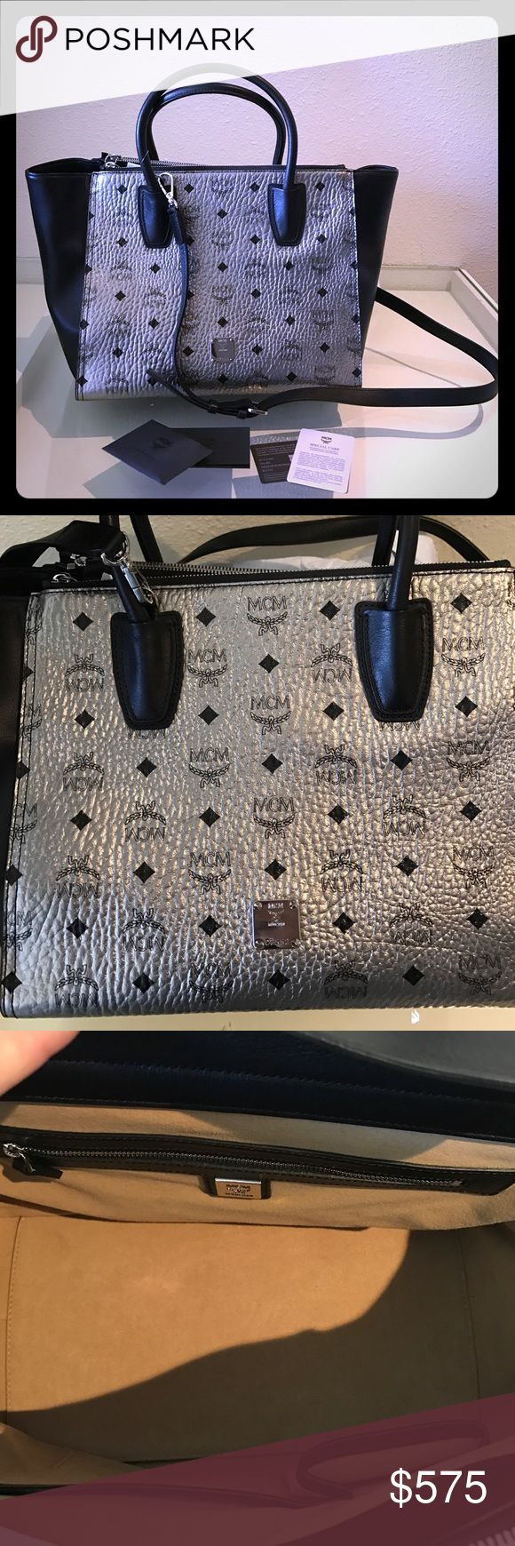 """Authentic MCM Kathy double zip Visetos satchel Gorgeous MCM silver and black handbag originally priced $959 plus tax. Roomy and fits everything in there. Comes with instructions on how to take care of this beautiful bag! Never been used. Does not come with dust bag.  Double handles, detachable adjustable crossbody strap Snap closure; lined Interior zip pocket, interior slip pocket, interior cell phone pocket, two exterior zip compartments 17""""L x 8""""W x 10""""H; 5"""" handle drop, 23"""" strap drop. No…"""