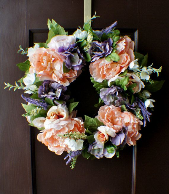 Beautiful and very bright front door wreath. I have used peach pink peonies and roses, blush roses, lavender anemones and tiny branches and greenery to make this wreath. It is approx 16+ inches in diameter. A perfect and welcoming front door decor. Will be great for both spring and