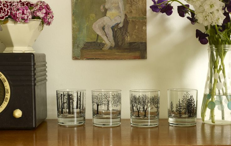 A beautiful set of four heavy bottomed glasses with bold printed images of trees. They are perfect for a glass of whisky in front of a roaring fire...The set includes one of each design; oak, blossom, birch and fir.  Code: 9000  9.5cm high. Handmade in Stoke, UK.  Hand wash only.