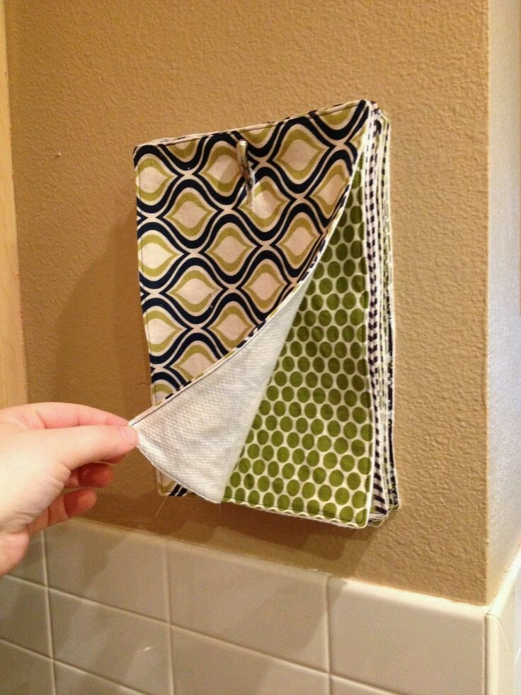 Un-Paper Towels on a hook! Just use a buttonhole sewing technique and hang on a command hook or even a banana hanger on the counter! (Image from Facebook User Rachel Boone on Fluff Love Sewing)