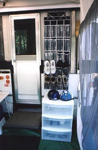 Shoes by the door- more room in the trailer this way. Keep it cleaner with the kids.