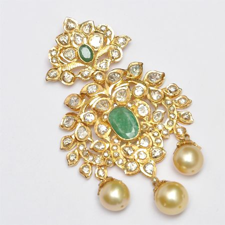 22k Gold pendant in uncut diamonds, emeralds and pearls.