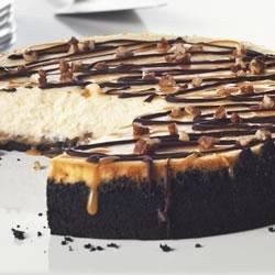 When we say 'ultimate,' we mean it. This delectable cheesecake boasts an OREO Cookie crust topped with a nutty layer of caramel and a classic cheesecake filling. Drizzles of melted chocolate and caramel-pecan sauce finish it off in style.