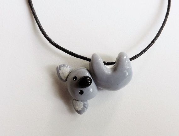 Cute koala hanging on a waxed cotton cord necklace.    Koala measures approximately 1.25 inches across and comes on an 18 long black cotton cord