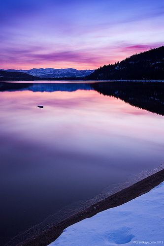 A Winter sunrise from Donner Lake's West End Beach in Truckee, California.