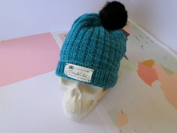 Luxury knitted merino beanie with black upcycled fur pompom, handmade from pure New Zealand wool, skull candy