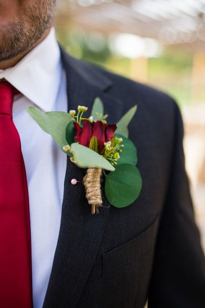 Groom in black suit, red tie + red rose and eucalyptus boutonniere {Savanna Sutton Photography}