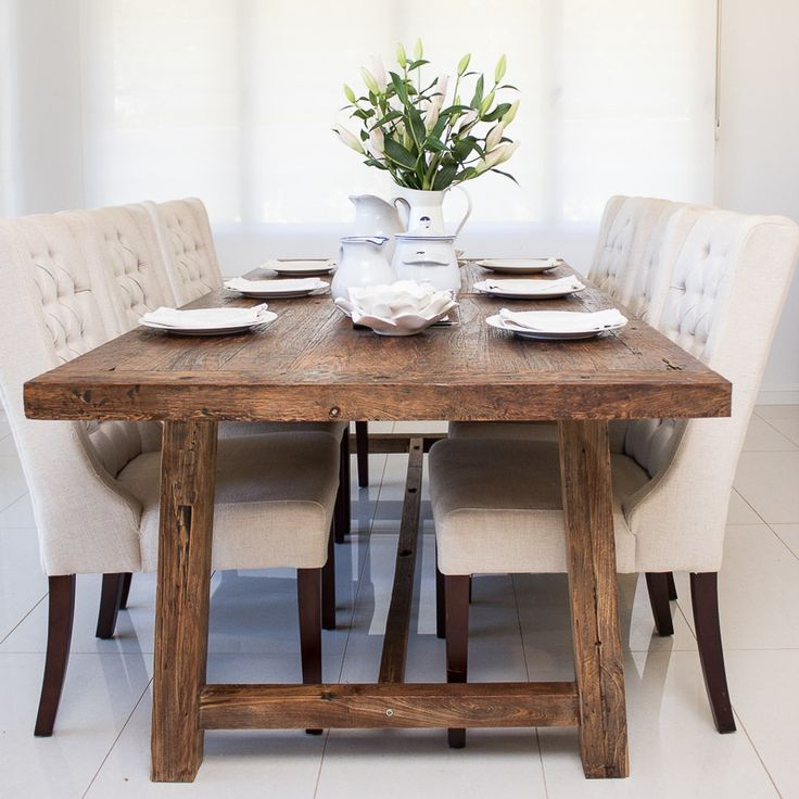 Dining area with linen tufted chairs. (SD Interiors)