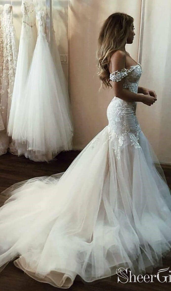 Off the shoulder mermaid wedding dress. #bohowedding #bohoweddingdresses #weddingdresses #weddingdress #weddings #weddinginspiration  #beachwedding #beachweddingdresses #vintagewedding #laceweddingdresses #rusticweddingdress
