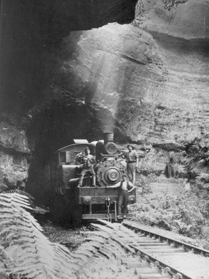 The crew pose for the camera on the front of locomotive #2, as it comes out of the Glowworm tunnel, heading towards Newnes.