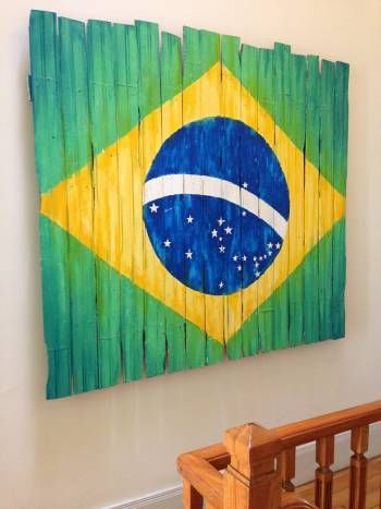 Old floorboards are transformed into a work of art in Rio de janeiro, Brazil. Recycled material now the Brazilian Flag.