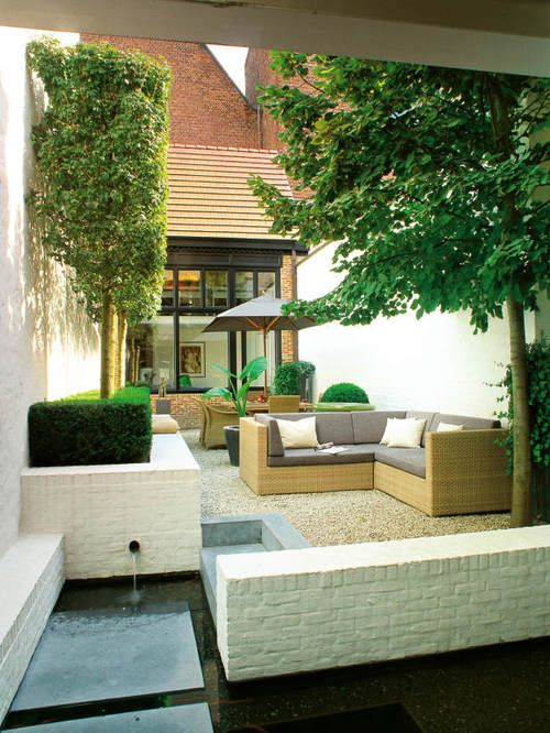Minimal Planting in Contemporary Garden Design Crisp contemporary furnishings help create a modern living space that was designed with very few plantings, making it a low maintenance garden for a professional owner with little free time.