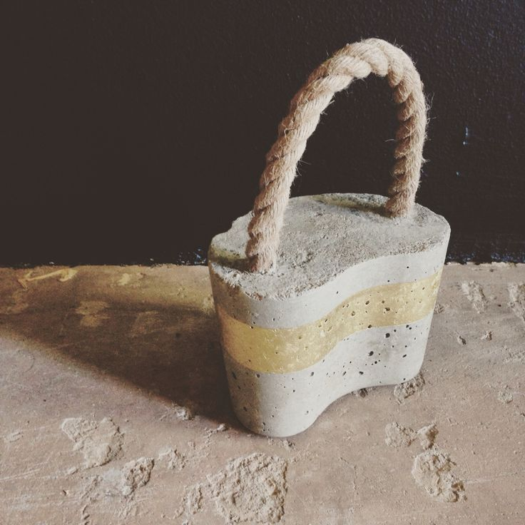 Concrete Doorstop available in variety of colours, see freerangeboy on Facebook for more info.
