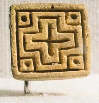 Seal with Greek cross, fired quartz, from Mohenjo-daro, Pakistan. Indus Valley Civilisation, 19th century BC.